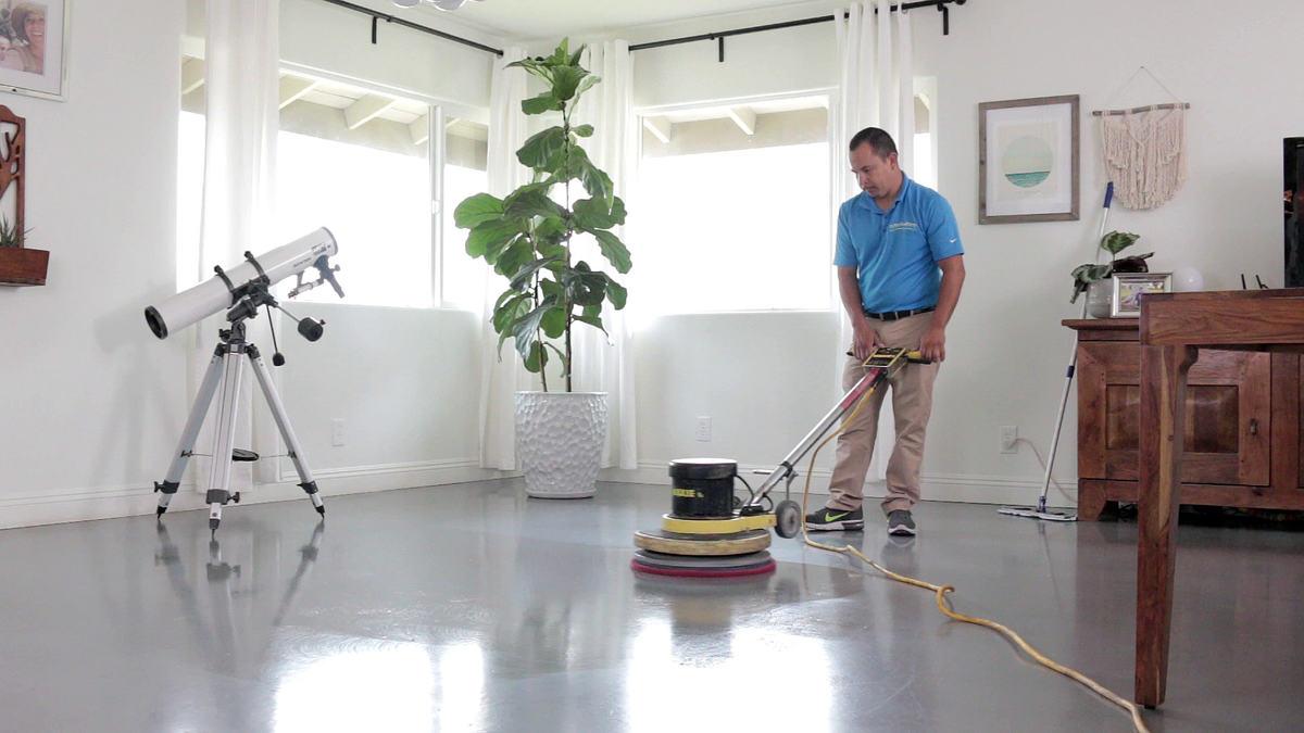 Polishing the floor with buffer (power head)